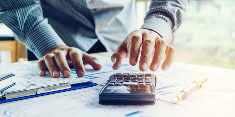 Financial adviser calculating