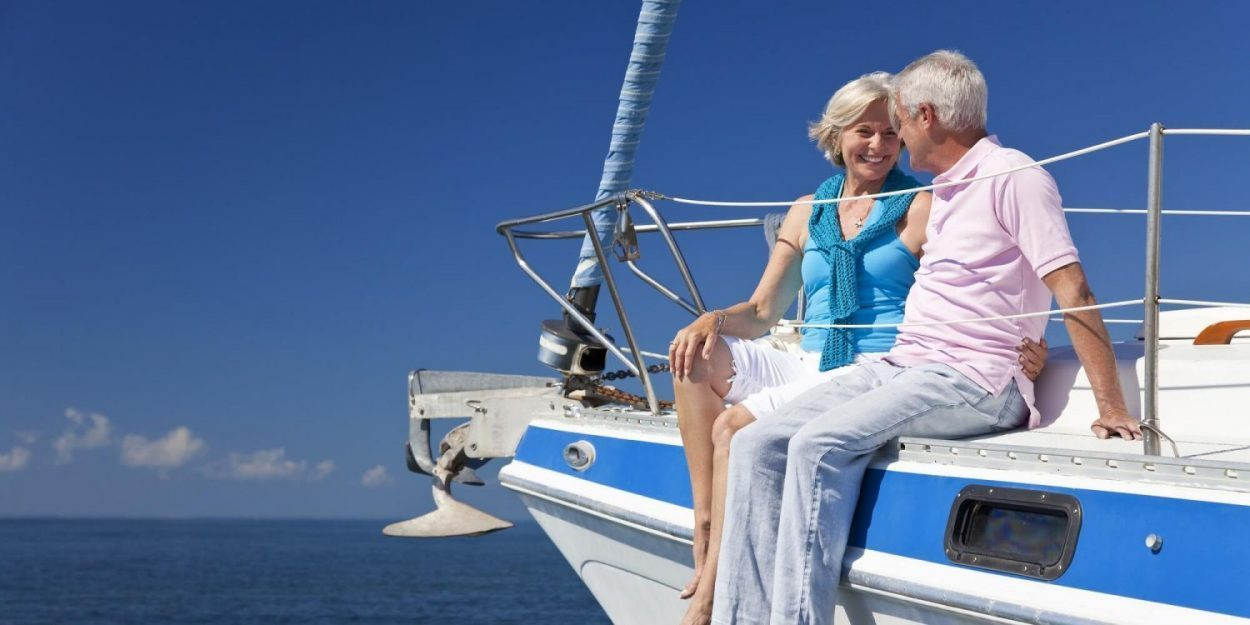 Elderly couple together on luxury boat, enjoying retirement